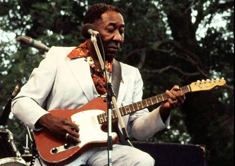 Muddy Waters playing on his Fender