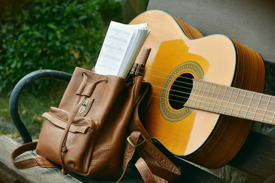 Guitar and bag on the bench